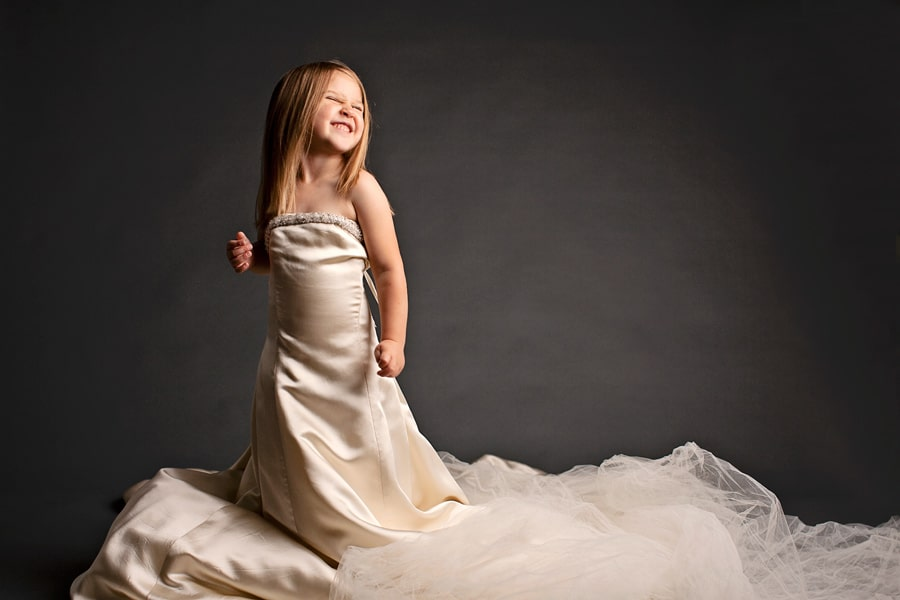 mom and daughter wearing generations of wedding dresses in sentimental photoshoot