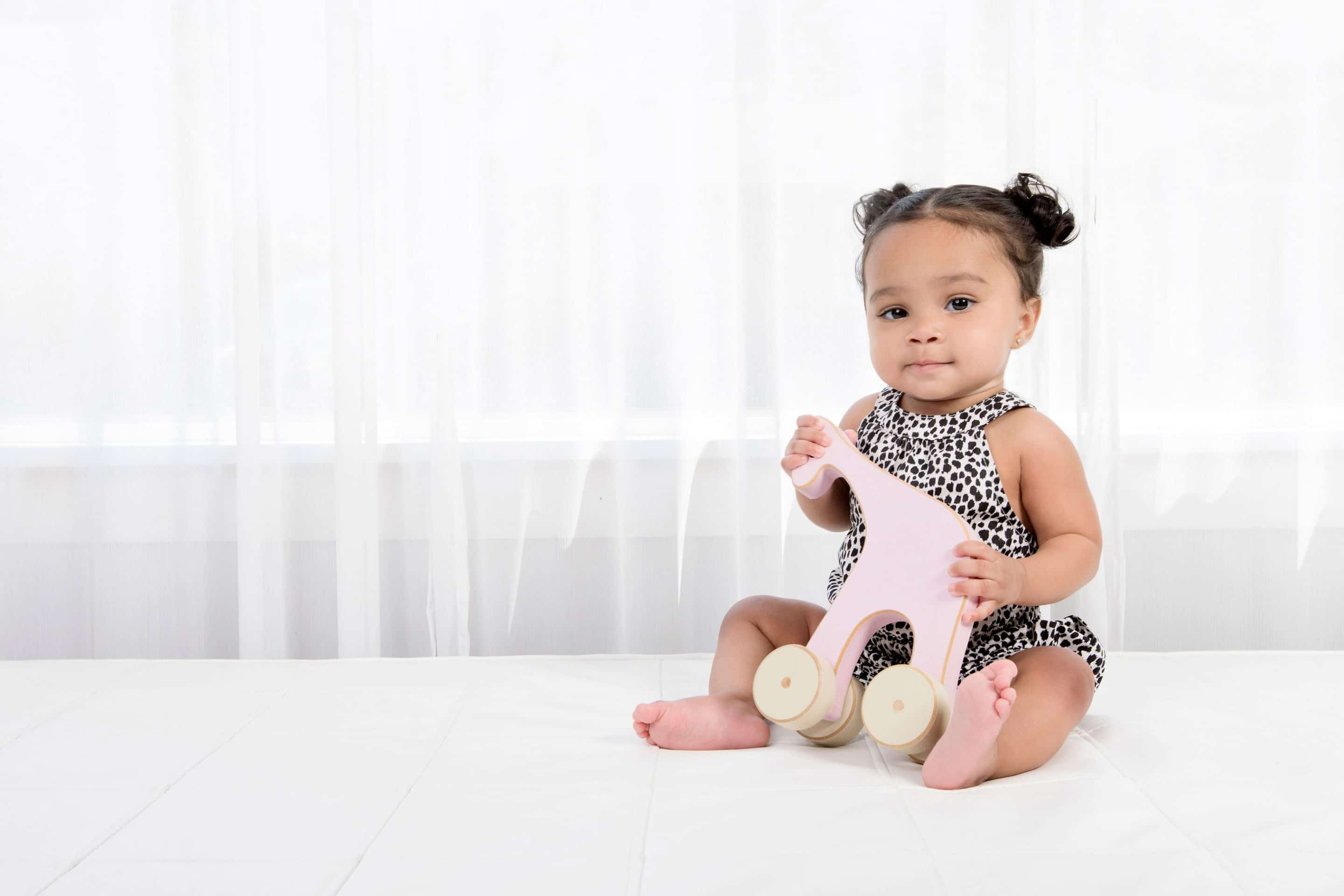 beautiful six-month session with little girl in private dallas studio