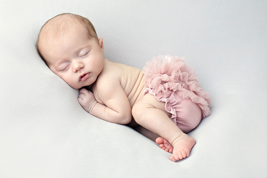 adorable baby girl wide awake in private studio