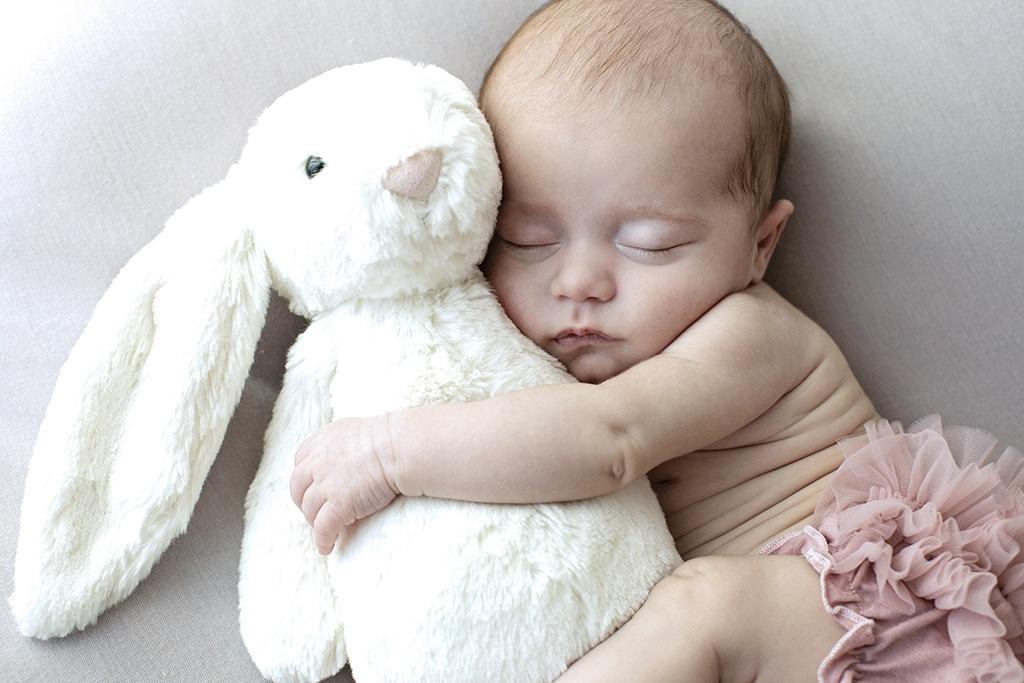 adorable baby girl wide awake in private studio