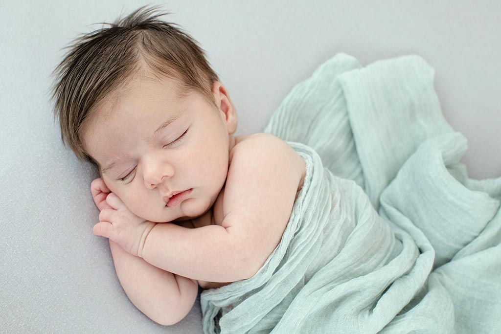 beautiful sleepy baby boy in private dallas studio