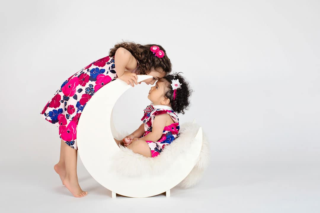 sisters playing around together in dallas studio
