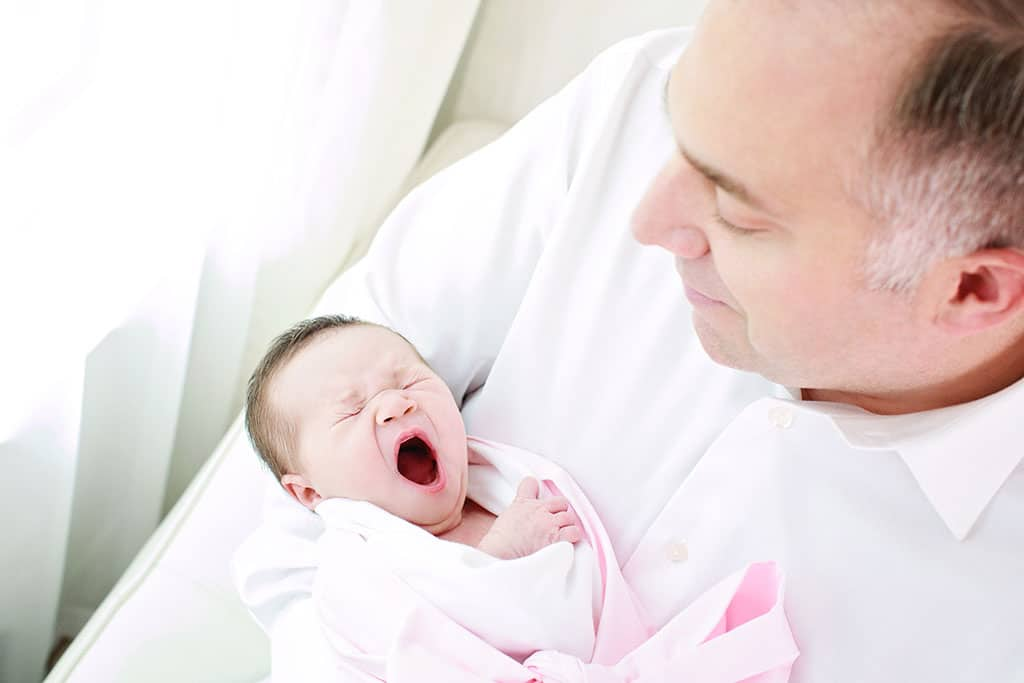 Beautiful first time parents with their little newborn girl