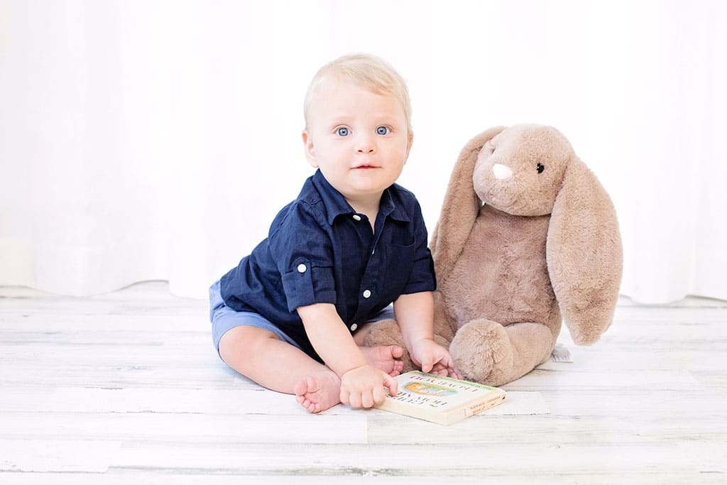 gorgeous six-month baby boy with bunny the size of him