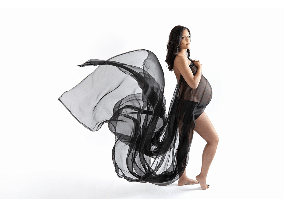 Pregnant mama in private dallas studio with dramatic and flowing dress