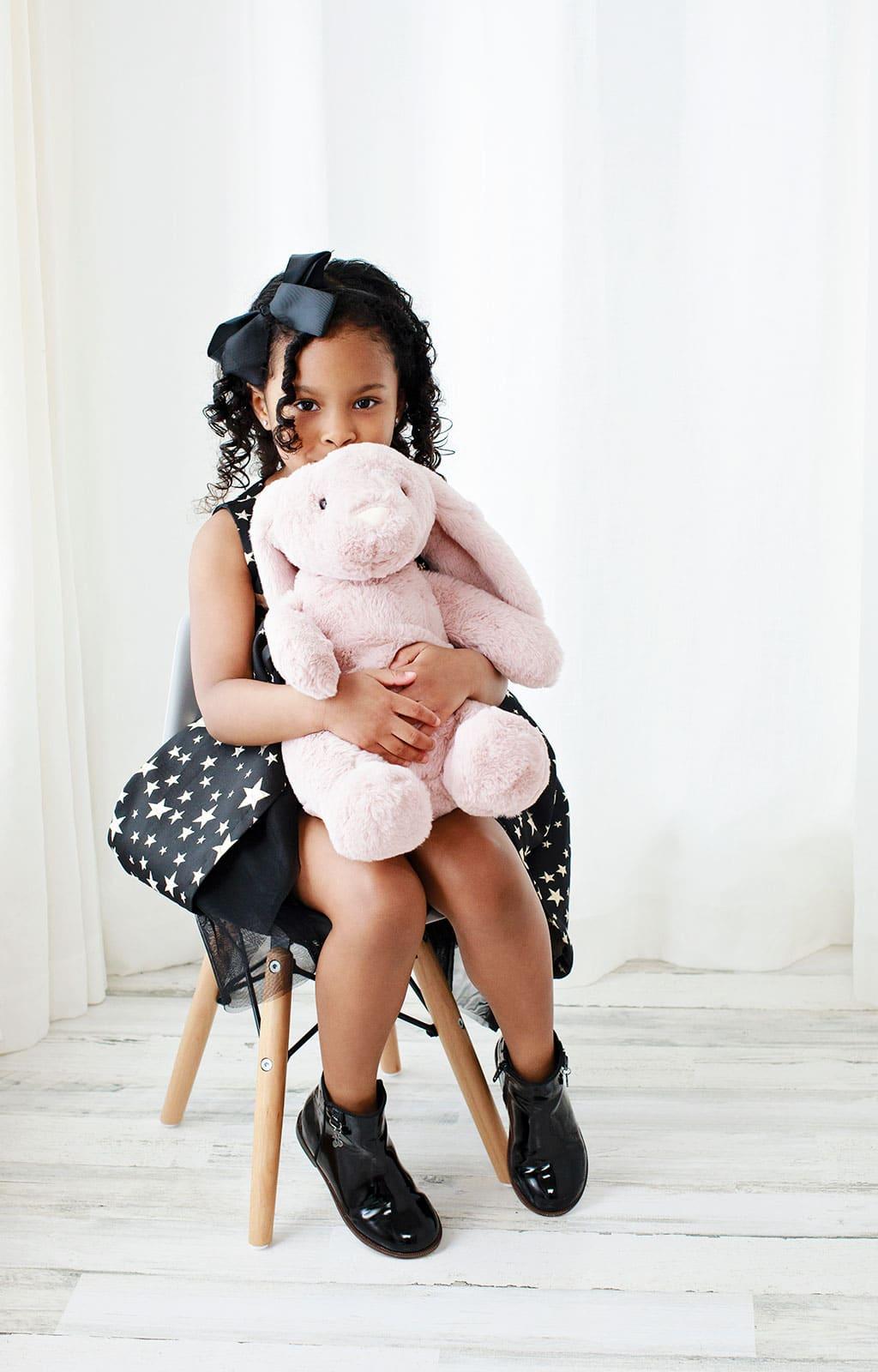 Little girl cuddles with bunny in private dallas studio