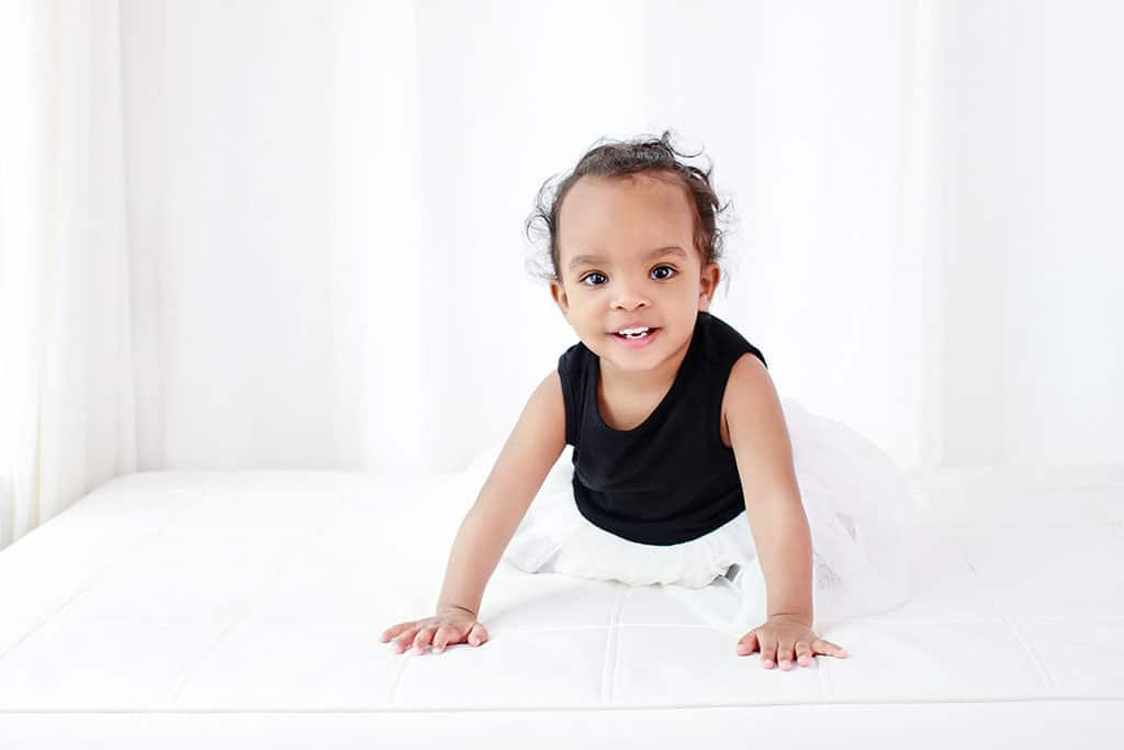 one year old crawling around in dallas studio to celebrate first birthday