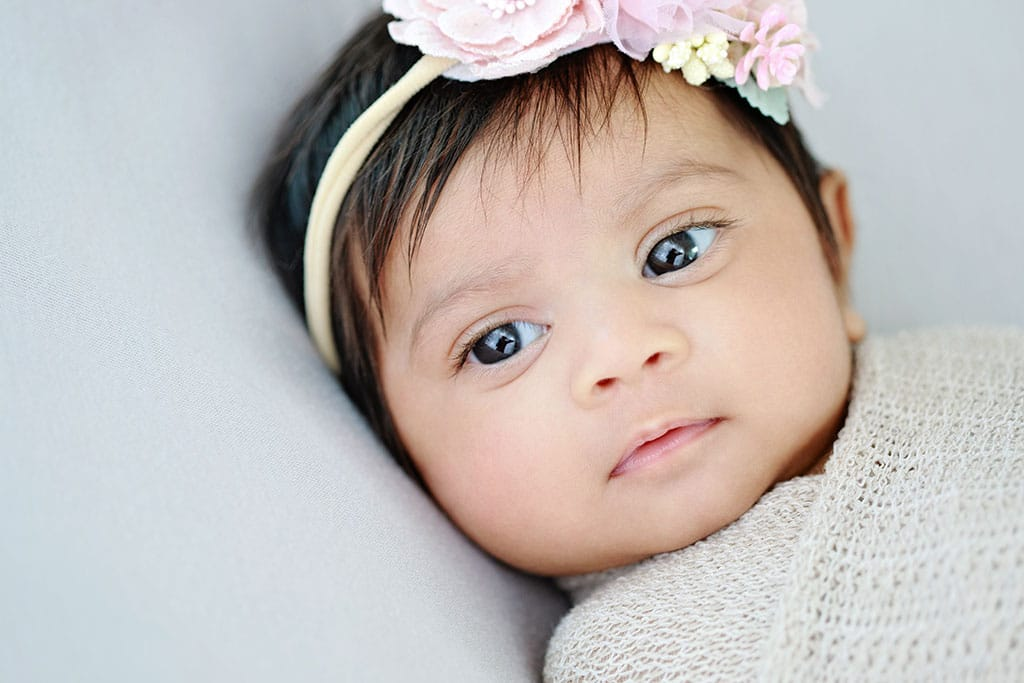 Beautiful 3-month-old baby girl in private studio session, with her parents