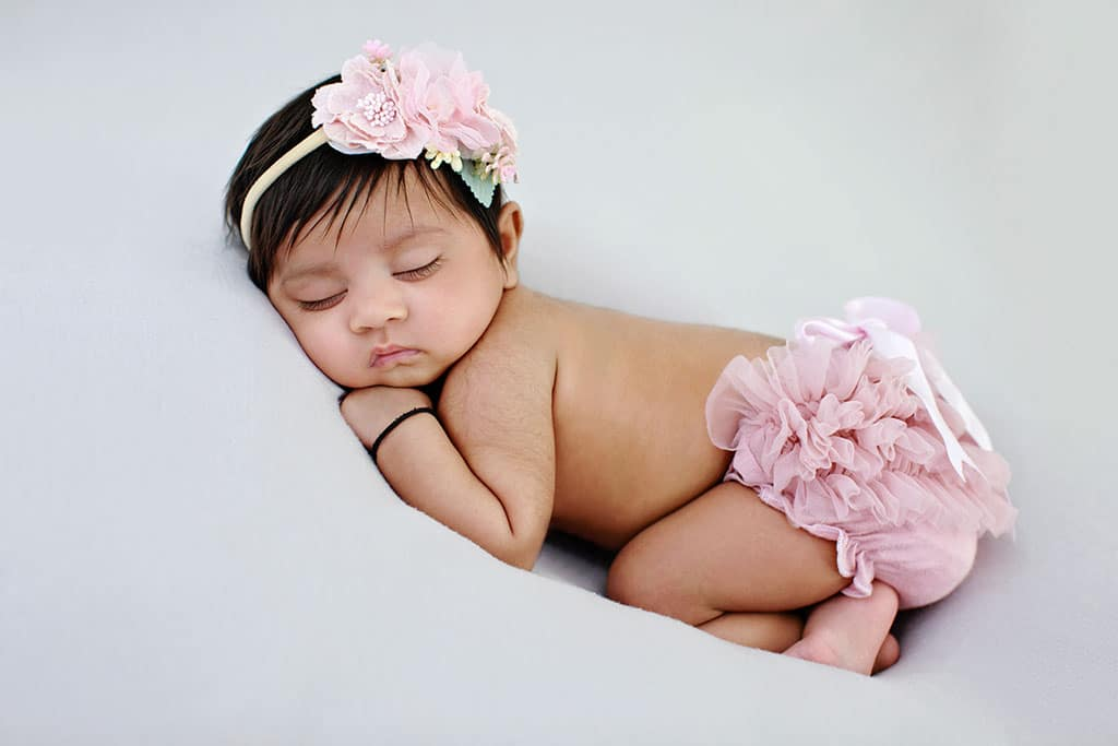 beautiful baby girl celebrating her first few months of life in private studio session