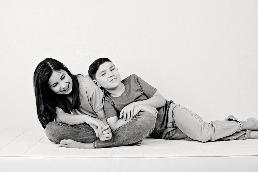 brother and sister posing in adorable studio session