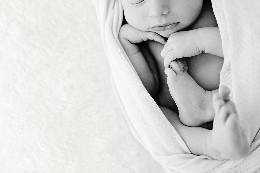 baby girl snuggled up in private dallas studio