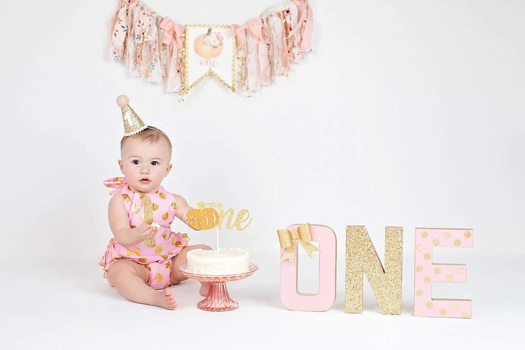 a very personalized first birthday session to capture baby's first milestone
