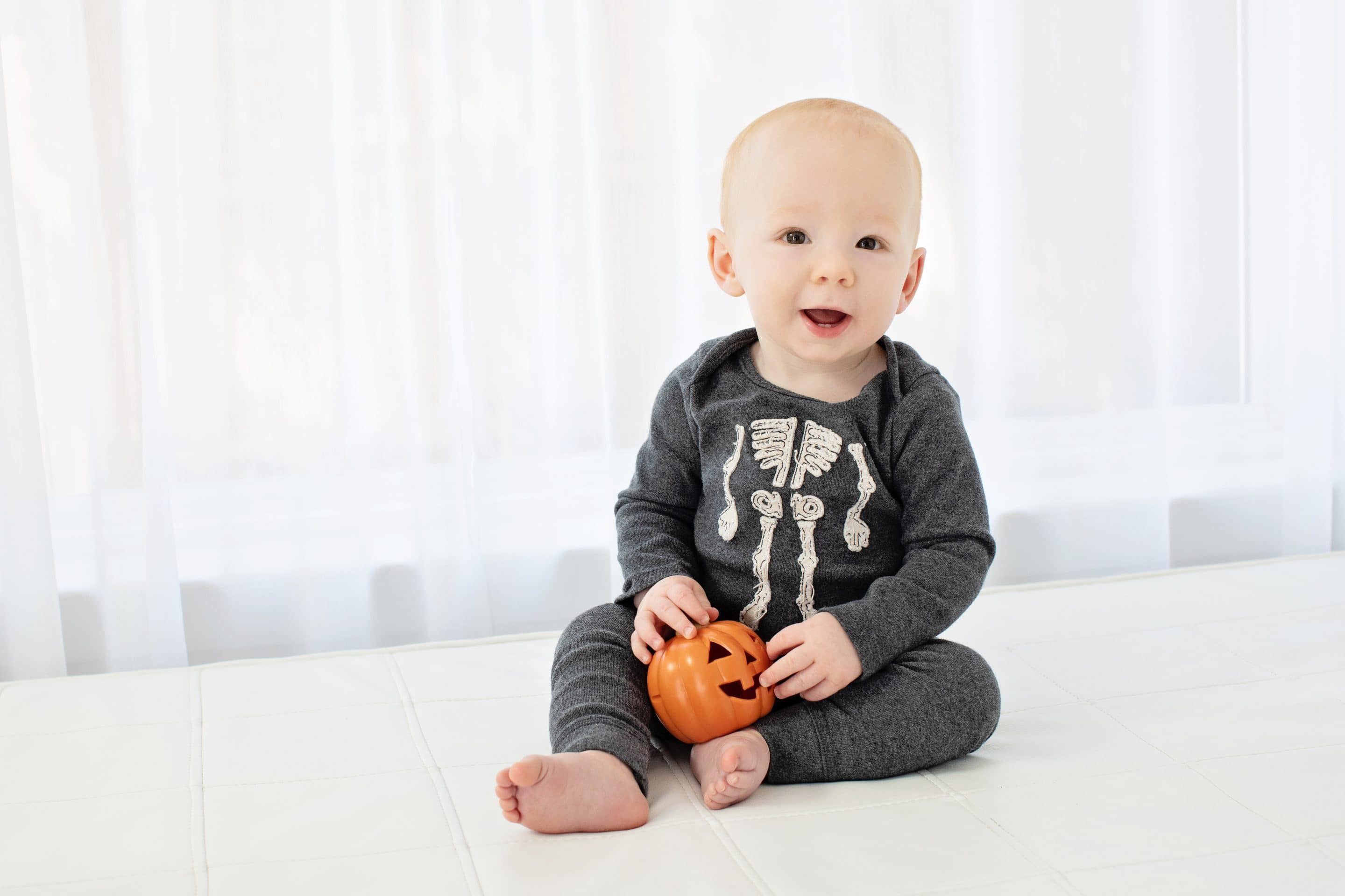 adorable baby in halloween outfit at studio session