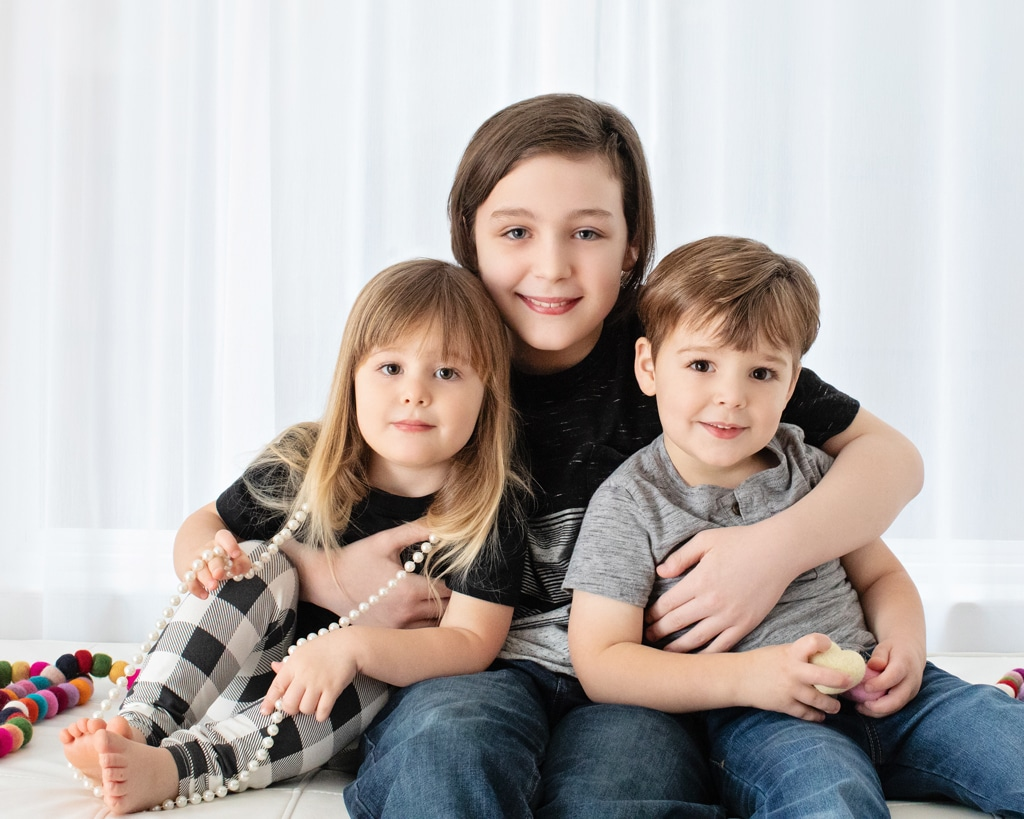 beautiful siblings cuddle up in studio session