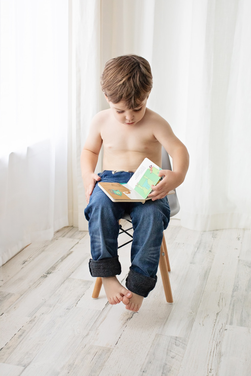 cute boy reads in private studio session