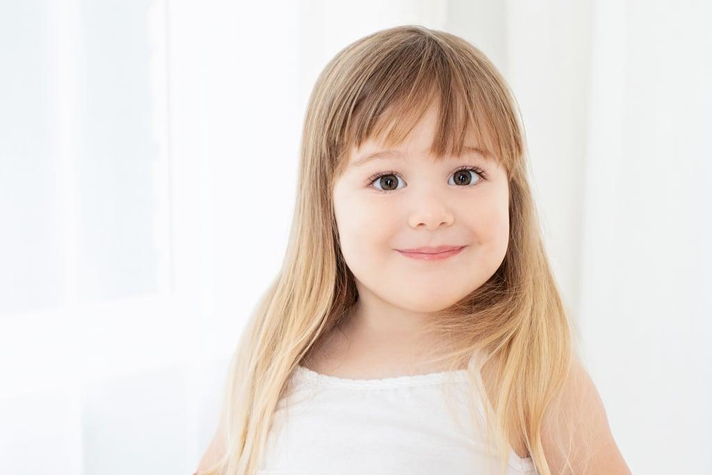 Gorgeous little girl posing for family session