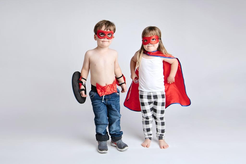 Siblings dressed as superhero's play around in private studio session