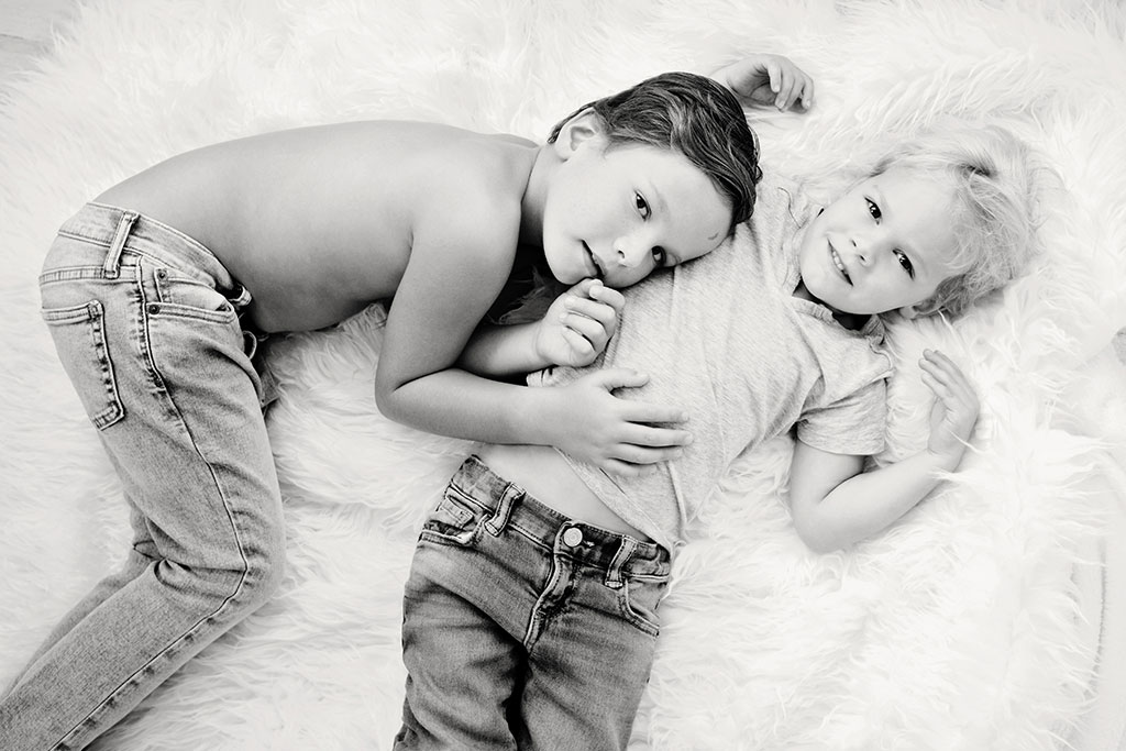 big brothers play around in studio session for newborn brother