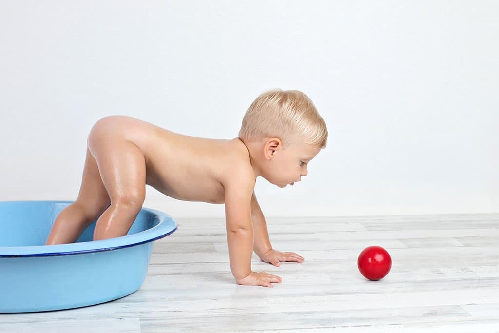 cute boy in post-cake bath