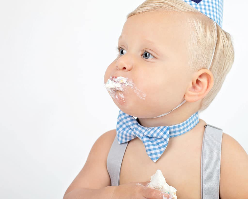 baby boy chows down on first birthday cake