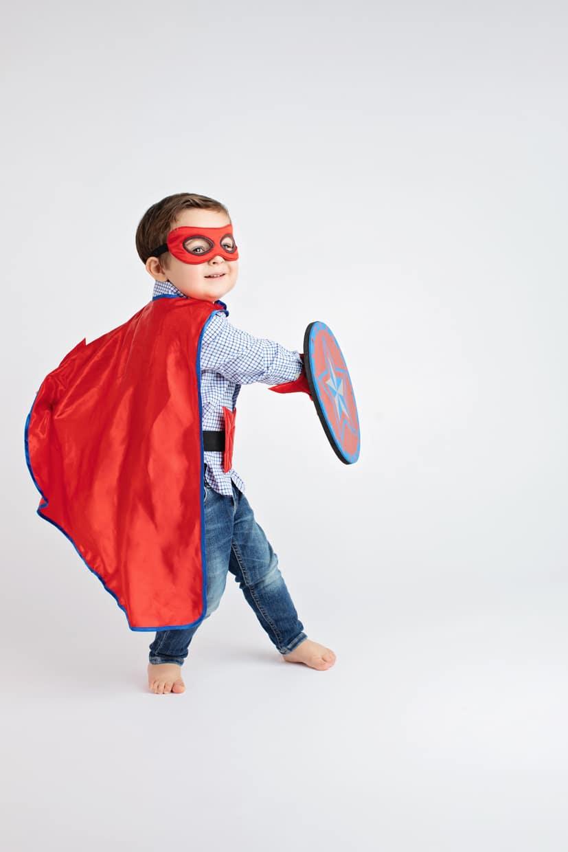 super kiddo runs around in private studio session dressed as a hero