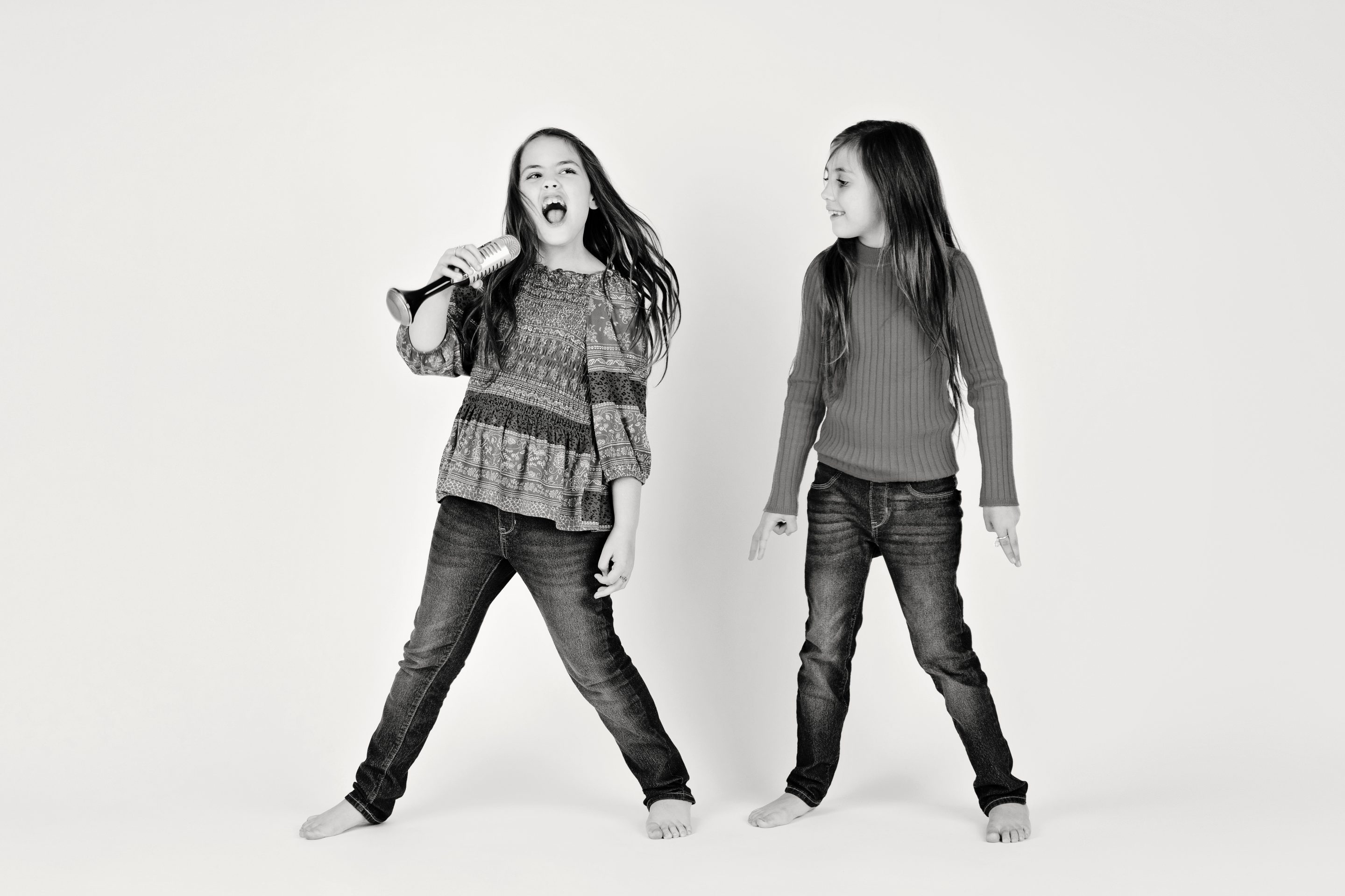 Sisters jumping around and having a blast in the studio