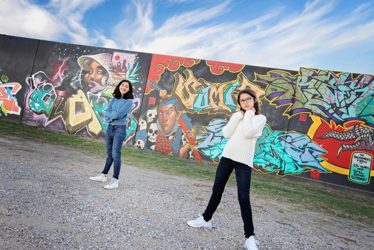 sisters posing in Dallas for a fun urban session