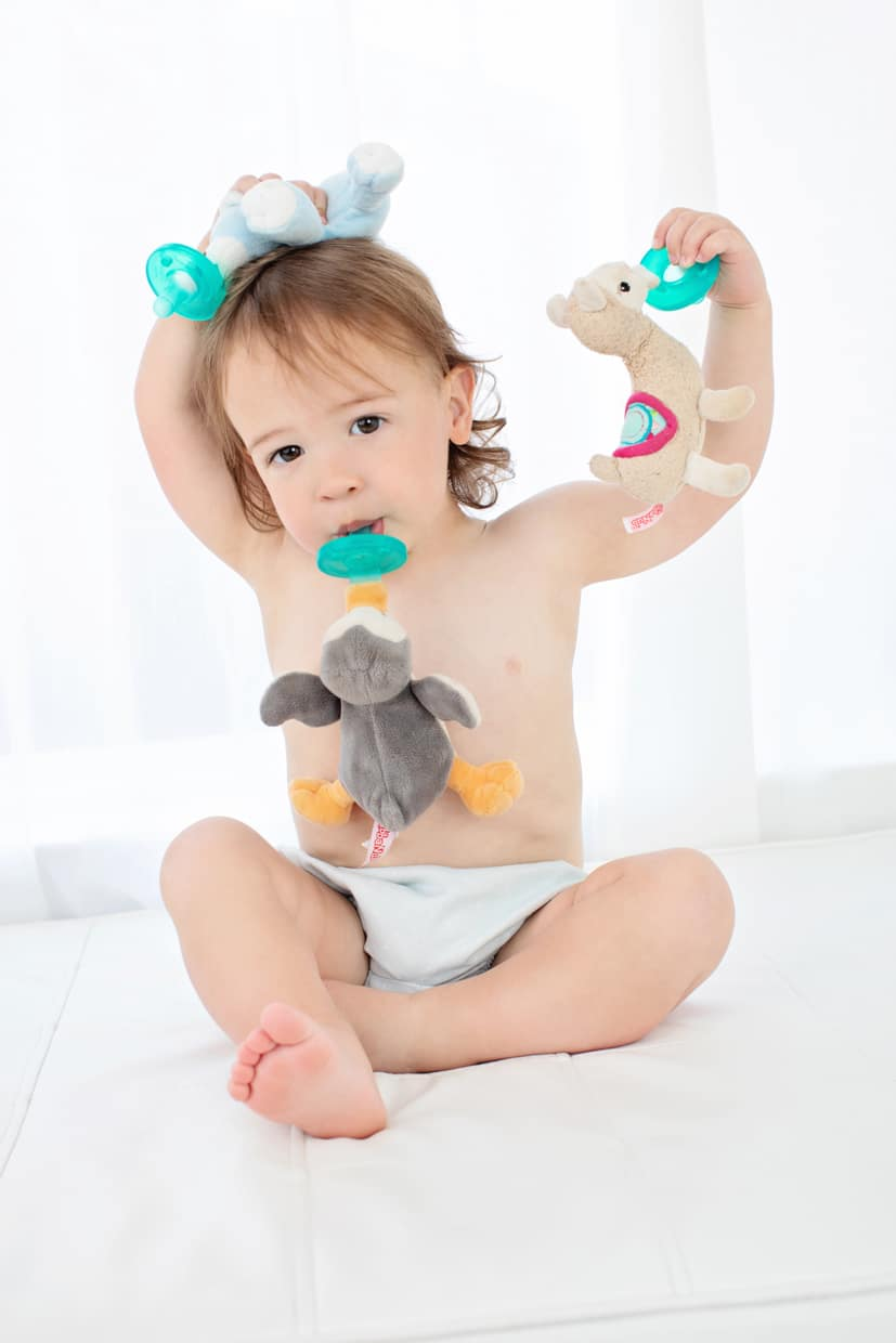 baby boy and his pacifiers in studio session