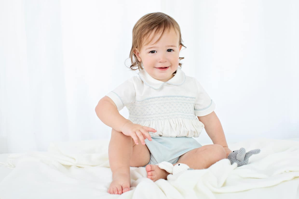 the most charming baby boy posing in private studio